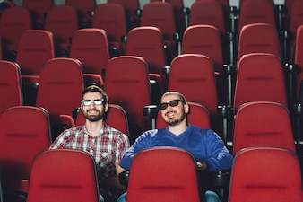 Friends watching film in cinema