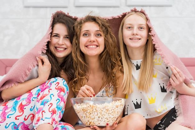 Friends watching a film