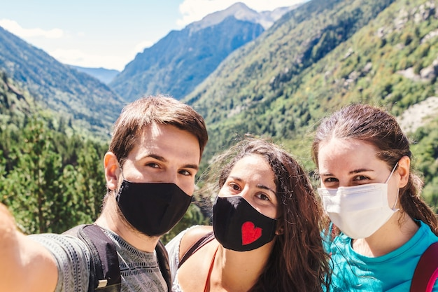 Friends wearing masks and taking a selfie