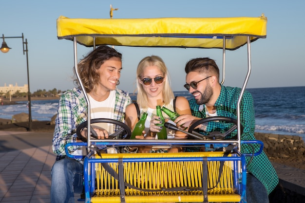 Friends with beer bottles in cart