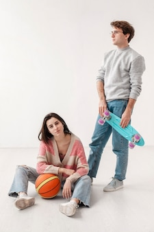 Friends with skateboard and basketball ball