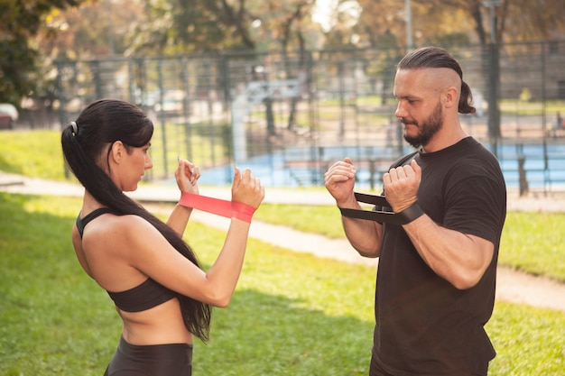 Friends working out with rubber band for hands