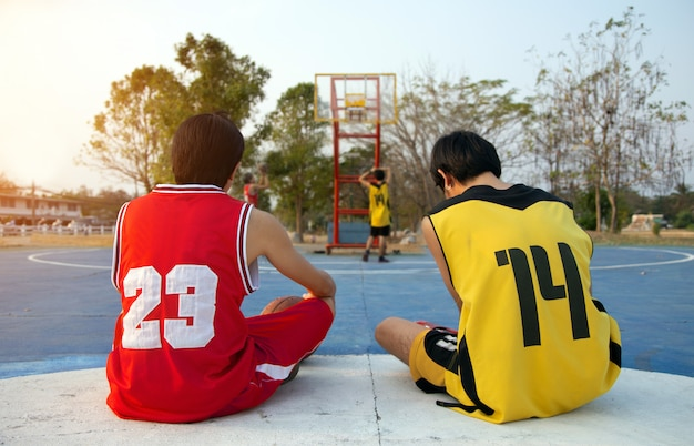 Friendship basketball sport game play outdoor court