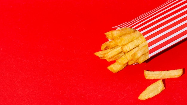 Fries on red background