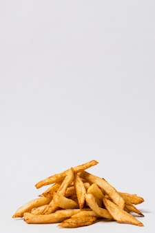 Fries on white background with copy space
