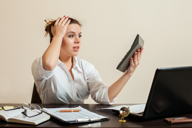 Frightened accountant looks at the balance sheet