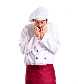 Frightened chef over white background