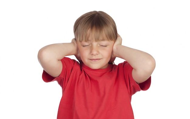 Frightened girl covering her ears