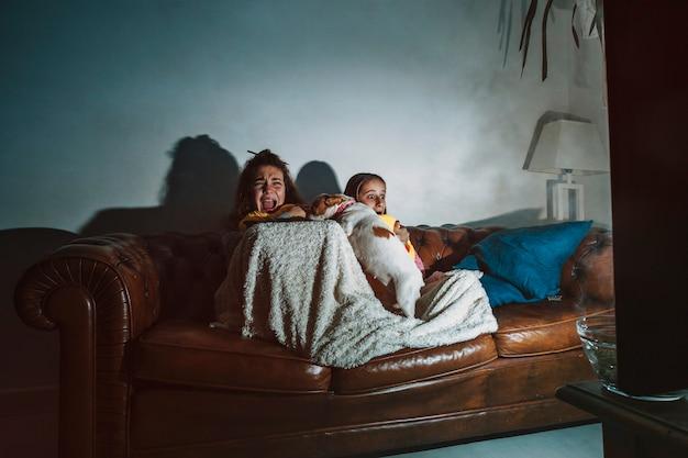 Frightened kids watching movie