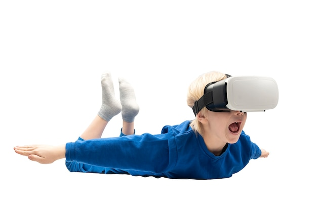 Frightened little boy in virtual reality glasses falls from height. white surface. video games concept.