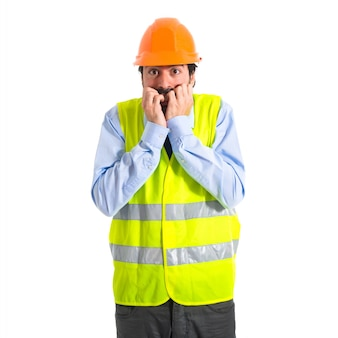 Frightened workman over white background