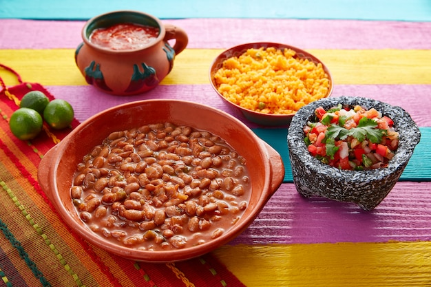Frijoles mexican beans with rice and sauces