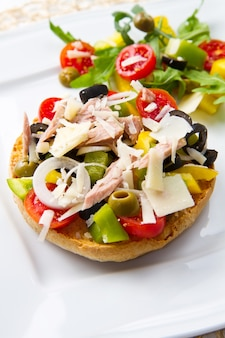 Frisella with vegetables and tuna