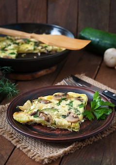 Frittata with mushrooms, zucchini and cheese