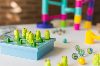 Frog game with marbles on table