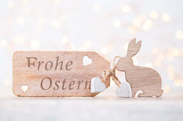 Frohe ostern message with easter decorations. greeting card.