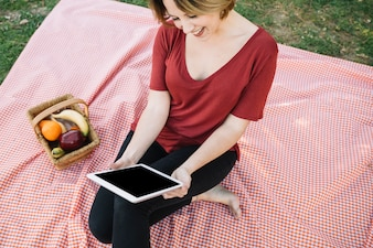 From above cheerful woman with tablet