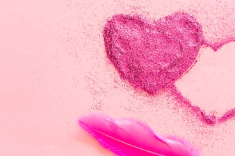 From above view of feather and heart
