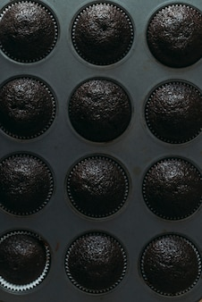 From above chocolate muffins in tin