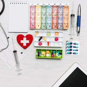 From above notebook near medication boxes