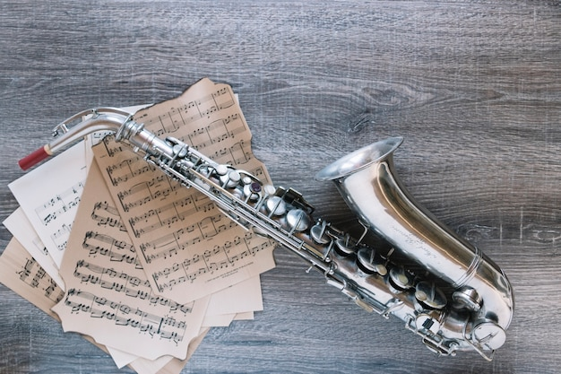 From above saxophone on sheet music