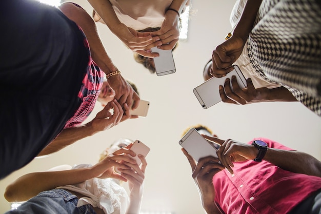 From below shot of students with phones