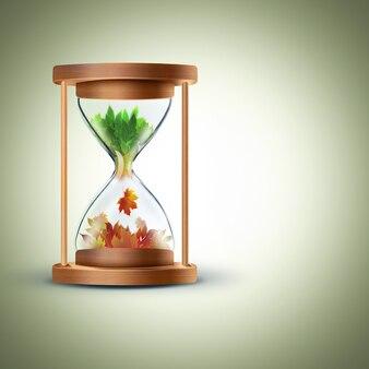 С лета на осень концепция смены времен года с песочными часами Premium Фотографии