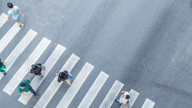 The from the top crosswise view of people walk on street pedestrian crossroad in the city street ,bird eye view