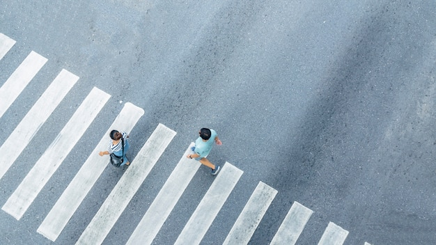 The from the top crosswise view of people walk on street pedestrian crossroad