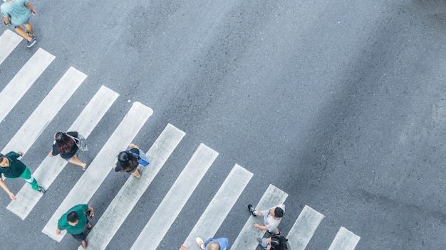 From the top view of people walk on street pedestrian crossroad in the city street