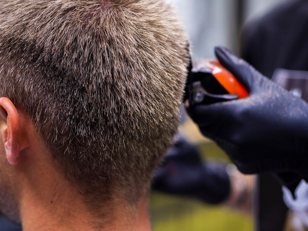 From behind view of trimmer and hairstyle