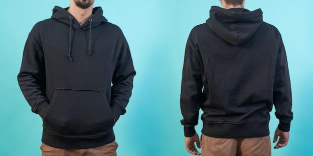 Вид спереди и сзади макета черной толстовки для дизайнерской печати на синем фоне