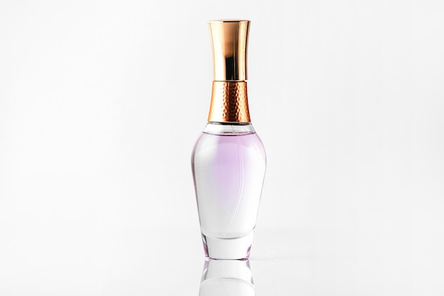 A front close up view bottle perfume transparent and bronze isolated on the white floor