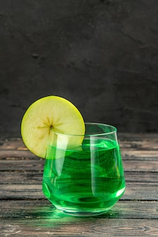 Front close view of fresh natural delicious juice in a glass on black background