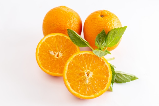 Front close view fresh whole oranges juicy and sour on the white surface
