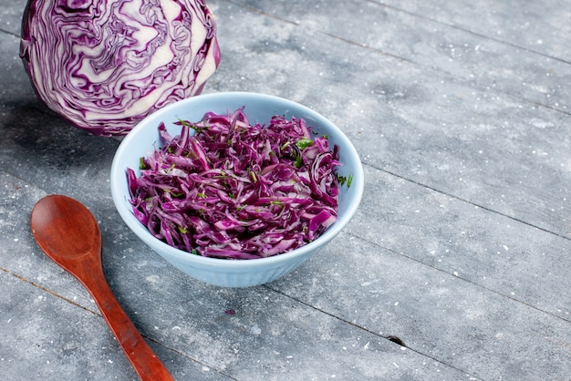Front close view purple cabbage ripe fresh sliced and whole on the grey rustic surface vegetable ripe food vitamine color