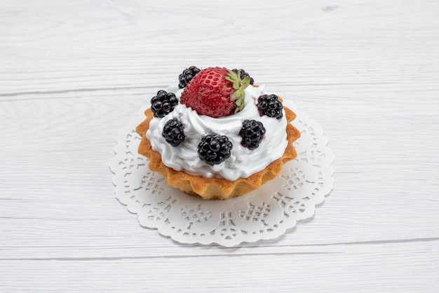 Front closer view delicious little cake with cream and berries on white
