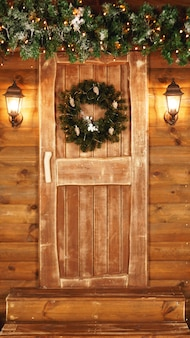 Front door decorated for the holidays. wooden fairy hut for christmas