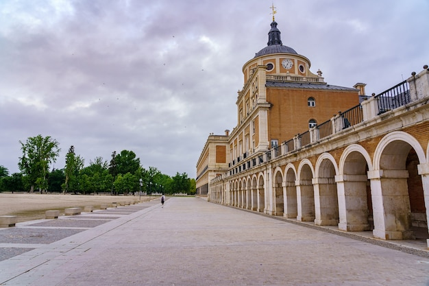 Front esplanade of the royal palace of aranjuez with its arcade and dome at the top