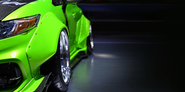 Front headlights of green modify car,copy space