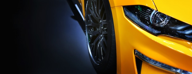 Front headlights of yellow modern car