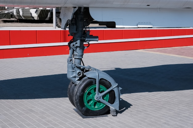 Front landing gear of big aircraft closeup detailed view. military equipment.