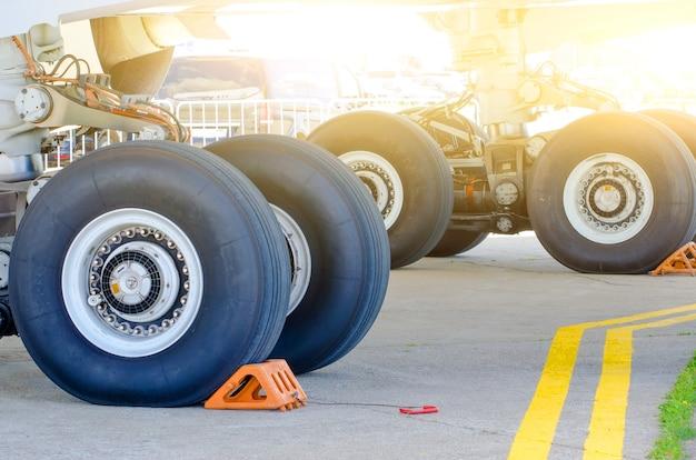 Front landing gear of big passenger aircraft closeup high detailed view.