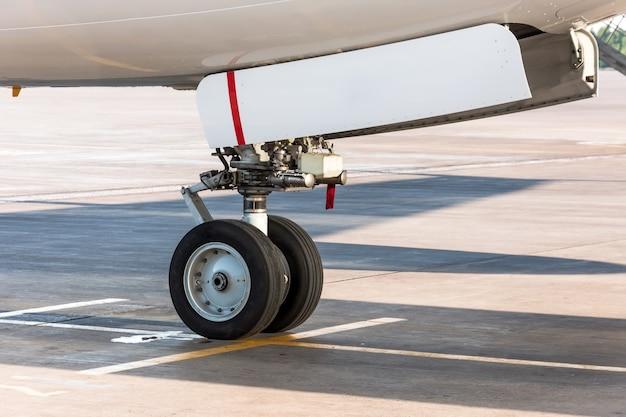 Front landing gear of passenger aircraft close up