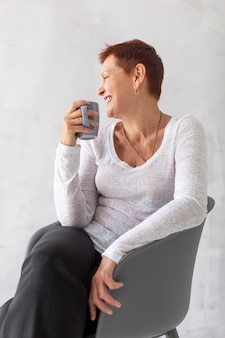 Front mature lady with mug looking away