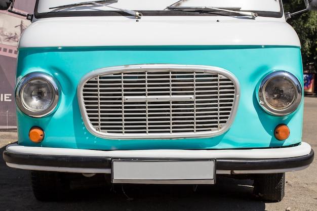 Front of a retro blue car.