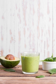 Front vies sliced avocado and smoothie glass