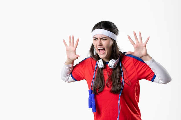 Front view angry young female in sport clothes