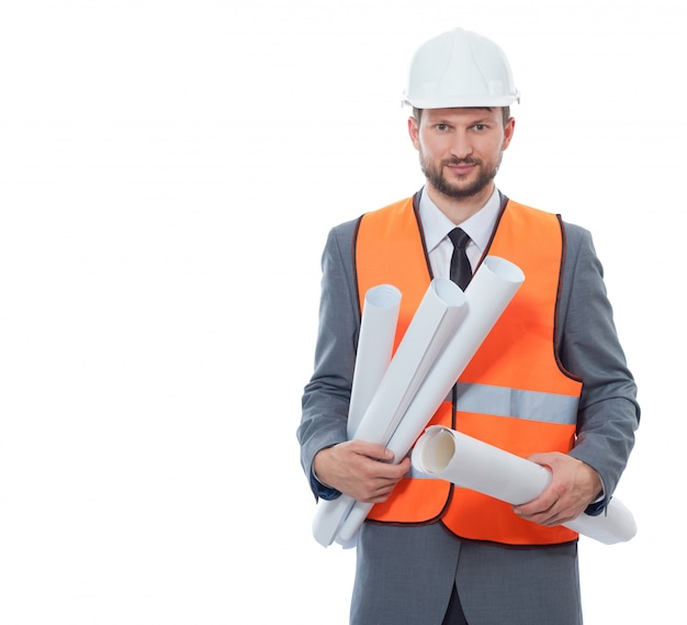 Front view of architect wearing in white safety hat and orange vest holding many paper drawing plans.