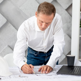 Front view architect working on complex plan